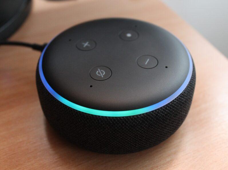 A smart speaker sitting on top of a desk